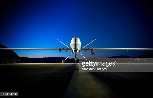 An MQ-9 Reaper sits on the flightline.
