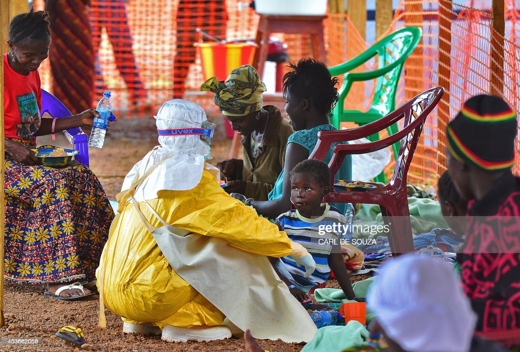 An MSF medical worker feeds an Ebola child victim at an MSF facility in Kailahun on August 15 2014 Kailahun along with Kenama district is at the...