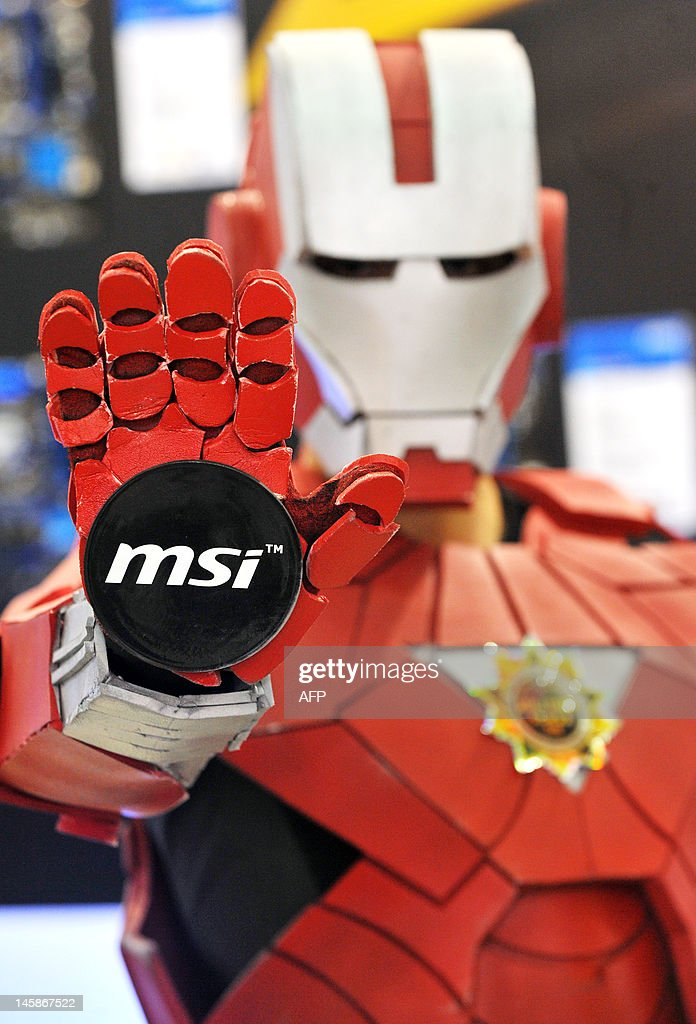 An MSi logo sticks to the palm of a promoter during the 2012 Computex in Taipei on June 7, 2012. Computex is Asia's leading IT trade fair. AFP PHOTO / Mandy CHENG