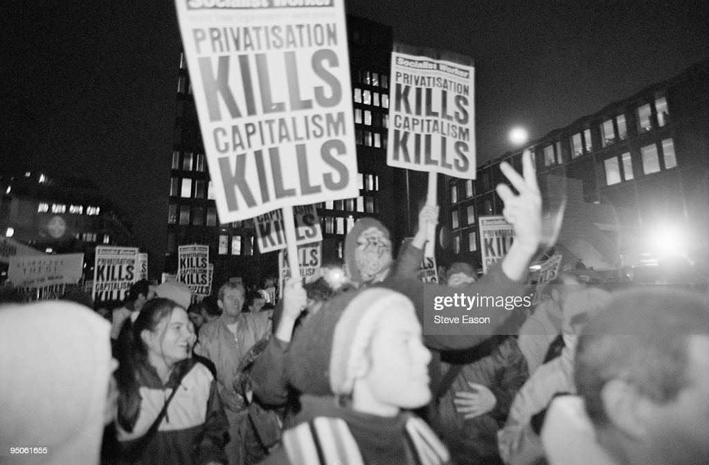An N30 march against the privatisation of the railways and the WTO outside Euston Station in London 30th November 1999 'Socialist Worker' placards...