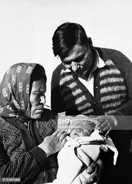 An native Canadian couple with their baby