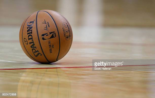An NBA basketball is seen on the court during the game between the San Antonio Spurs and the Houston Rockets at the Toyota Center on December 25 2015...