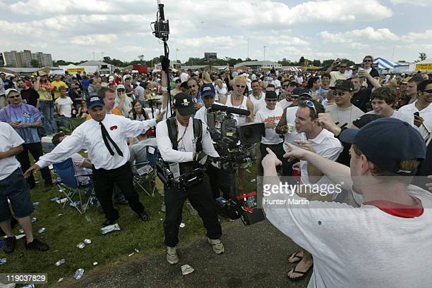An NBC cameraman does some filming of fans in the infield at the 131st Preakness Stakes at Pimlico Race Track in Baltimore Maryland on Saturday May...