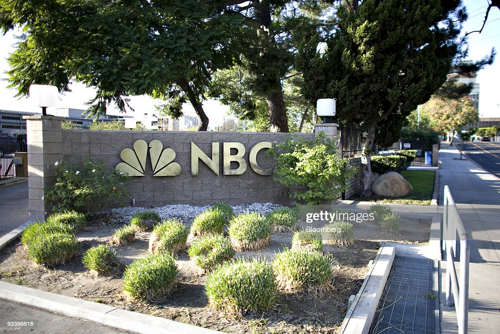 An NBC logo hangs outside NBC studios in Burbank California US on Tuesday Nov 24 2009 General Electric Co is leaning toward allowing an initial...
