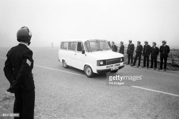 An NCB van drives past a line of policemen today while carrying rebel miner Brian Green and an unnamed colleague to Gascoigne Wood colliery in...