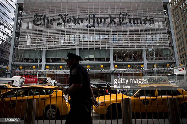 An New York City Police Department police officer passes in front of The New York Times Co offices in New York US on Wednesday July 31 2013 The New...