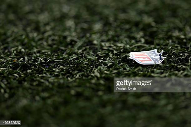 An NFL logo is seen on the field as the Baltimore Ravens play the San Diego Chargers at MT Bank Stadium on November 1 2015 in Baltimore Maryland