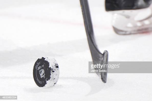 An NHL puck sits on the ice during a game against the Columbus Blue Jackets and Philadelphia Flyers on February 13 2015 at Nationwide Arena in...