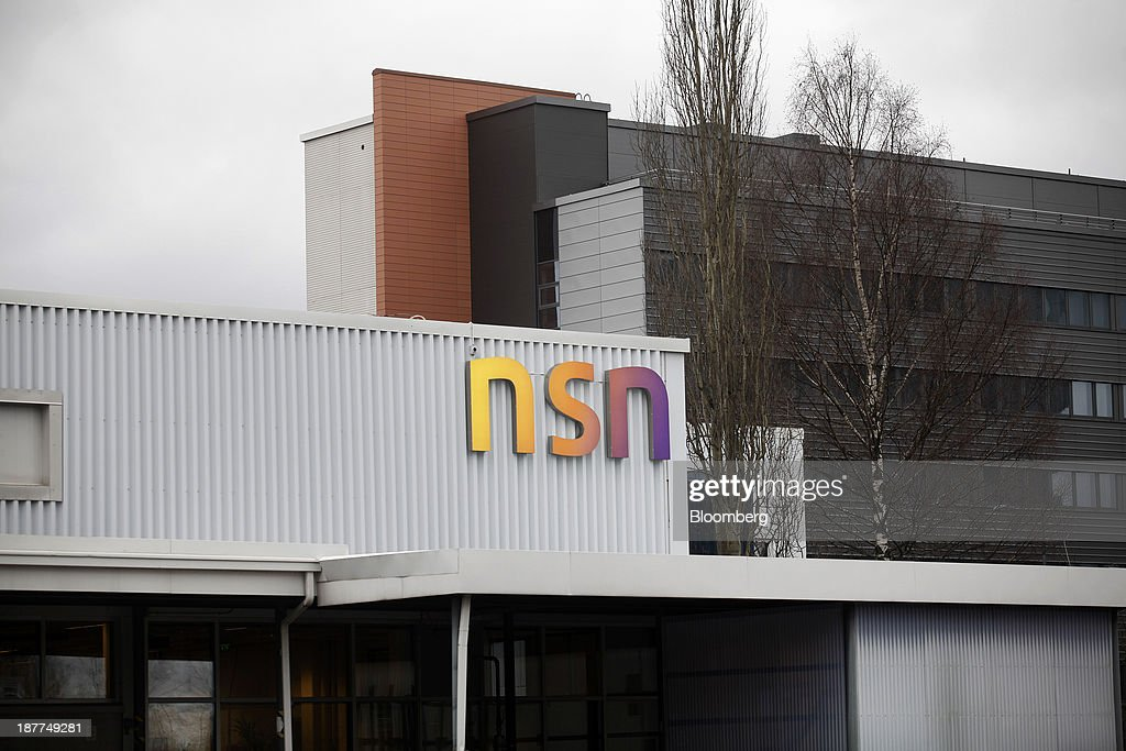 An NSN logo sits on display at the headquarters of Nokia Solutions And Networks Oy (NSN), a division of Nokia Oyj, in Espoo, Finland, on Tuesday, Nov. 12, 2013. Nokia, which will get more than 90 percent of sales from NSN after the handset-division sale to Microsoft, has cut more than 21,000 jobs to rejuvenate the business. Photographer: Ville Mannikko/Bloomberg via Getty Images