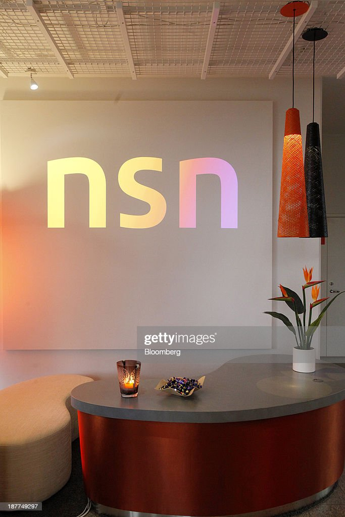An NSN logo sits on display inside the Solutions Experience Center at the headquarters of Nokia Solutions And Networks Oy (NSN), a division of Nokia Oyj, in Espoo, Finland, on Tuesday, Nov. 12, 2013. Nokia, which will get more than 90 percent of sales from NSN after the handset-division sale to Microsoft, has cut more than 21,000 jobs to rejuvenate the business. Photographer: Ville Mannikko/Bloomberg via Getty Images