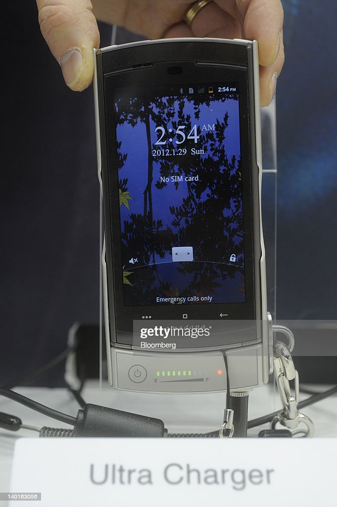 An NTT DoCoMo Inc. Medias smartphone, which features a 10-minute charging time, sits on display at the company's booth at the Mobile World Congress in Barcelona, Spain, on Wednesday, Feb. 29, 2012. The Mobile World Congress, operated by the GSMA, expects 60,000 visitors and 1400 companies to attend the four-day technology industry event which runs Feb. 27 through March 1. Photographer: Denis Doyle/Bloomberg via Getty Images