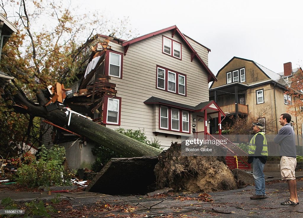 An oak tree leveled part of a house on Larch Road in Cambridge, Tuesday, October 30, 2012, after a storm caused by Hurricane Sandy hit Massachusetts.