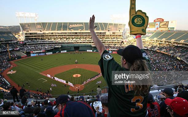 An Oakland A's fan cheers before the start of the Opening Day game of the Oakland Athletics and The Boston Red Sox at the McAfee Coliseum April 1...