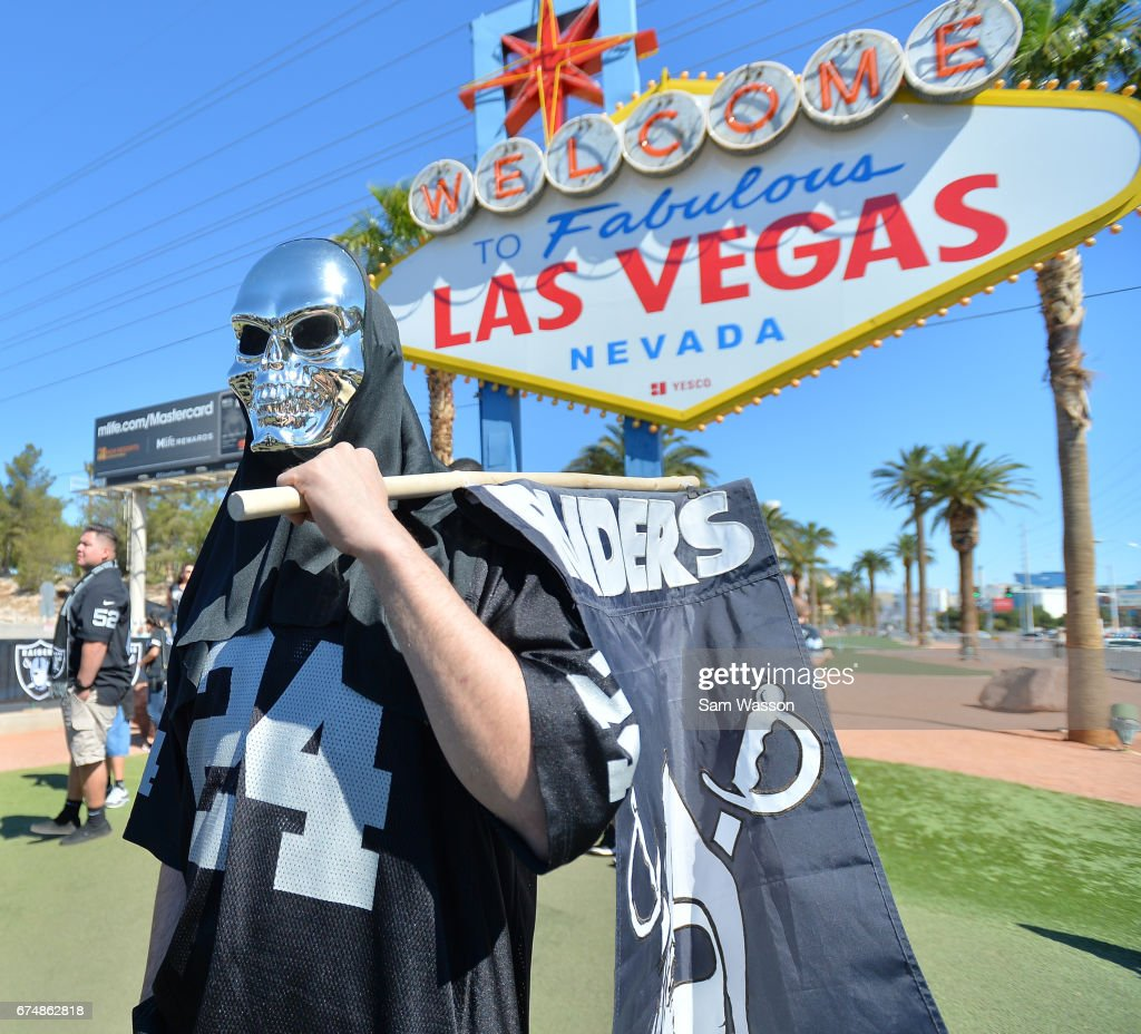 An Oakland Raiders fan attends the team's 2017 NFL Draft event at the Welcome to Fabulous Las Vegas sign on April 29, 2017 in Las Vegas, Nevada. National Football League owners voted in March to approve the team's application to relocate to Las Vegas. The Raiders are expected to begin play no later than 2020 in a planned 65,000-seat domed stadium to be built in Las Vegas at a cost of about USD 1.9 billion.