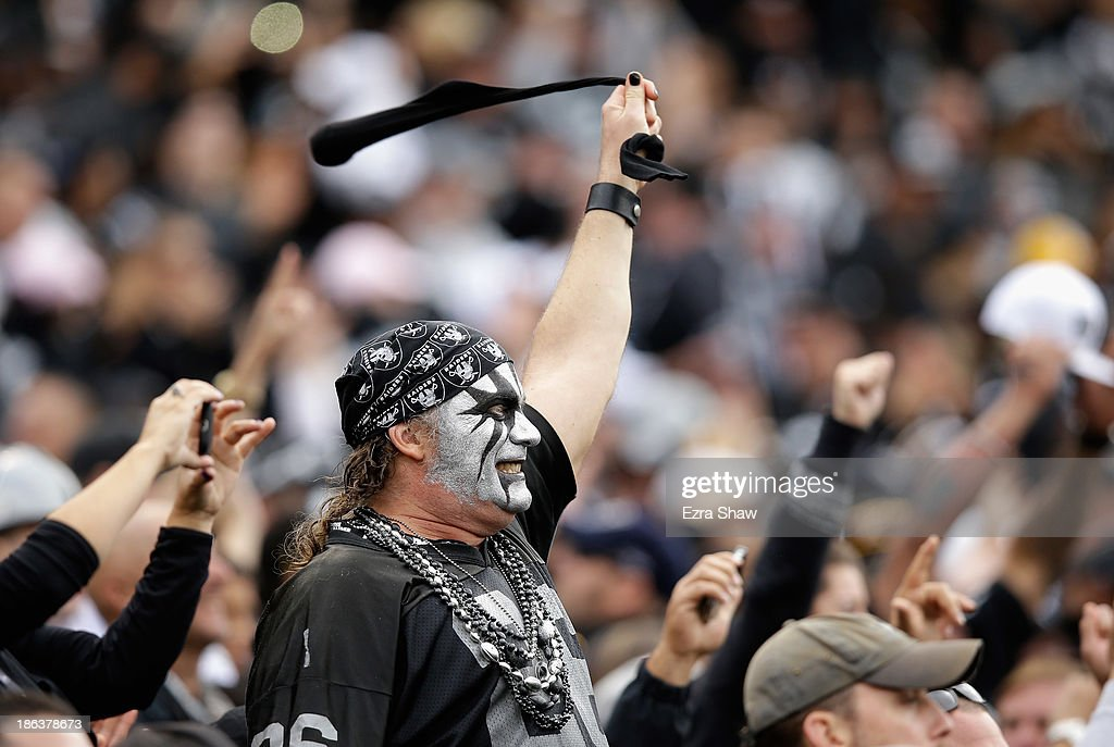 An Oakland Raiders fan cheers on his team during their game against the Pittsburgh Steelers at O.co Coliseum on October 27, 2013 in Oakland, California.
