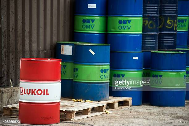 An OAO Lukoil branded barrel sits in front of stacked OMV AG branded barrels at the OMV AG Schwechat oil refinery in Schwechat Austria on Wednesday...