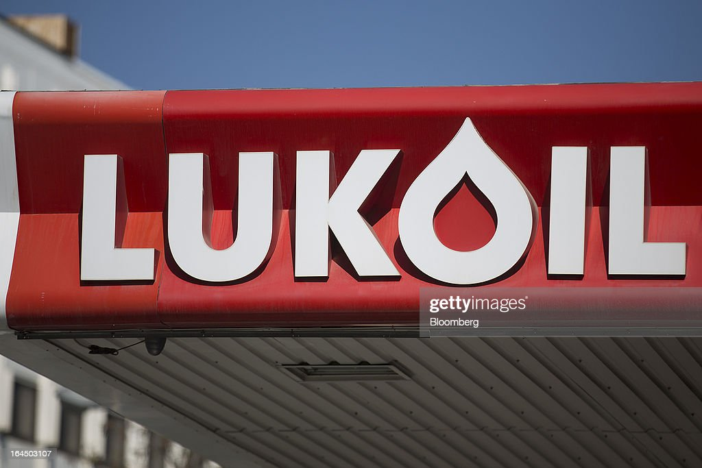 An OAO Lukoil logo sits on the roof of a gas station in Nicosia, Cyprus, on Sunday, March 24, 2013. Cyprus's fate hangs in the balance as euro-area finance ministers meet today to decide whether the tiny Mediterranean island has done enough for a bailout that will avert its financial collapse. Photographer: Simon Dawson/Bloomberg via Getty Images