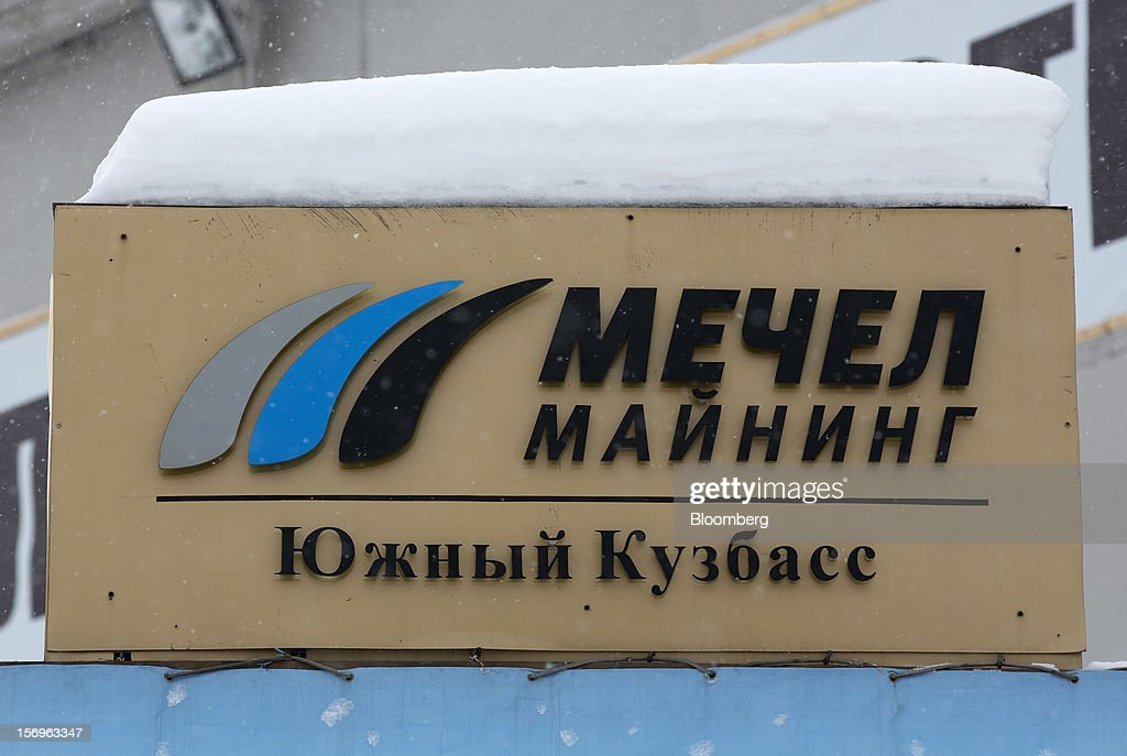 An OAO Mechel logo sits on a sign at the Sibirginsky open pit coal mine, owned by OAO Mechel and operated by Southern Kuzbass Coal Co., near Myski, in Kemerovo region of Siberia, Russia, on Friday, Nov. 23, 2012. OAO Mechel is Russia's biggest maker of steelmaking coal. Photographer: Andrey Rudakov/Bloomberg via Getty Images