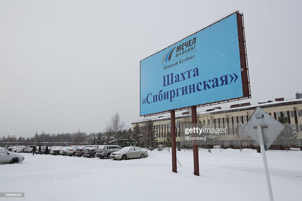 An OAO Mechel sign stands at the the entrance to the Sibirginsky open pit coal mine, owned by OAO Mechel and operated by Southern Kuzbass Coal Co., near Myski, in Kemerovo region of Siberia, Russia, on Friday, Nov. 23, 2012. OAO Mechel is Russia's biggest maker of steelmaking coal. Photographer: Andrey Rudakov/Bloomberg via Getty Images
