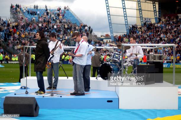 An Oasis tribute entertain the crowd at the final game at Maine Road