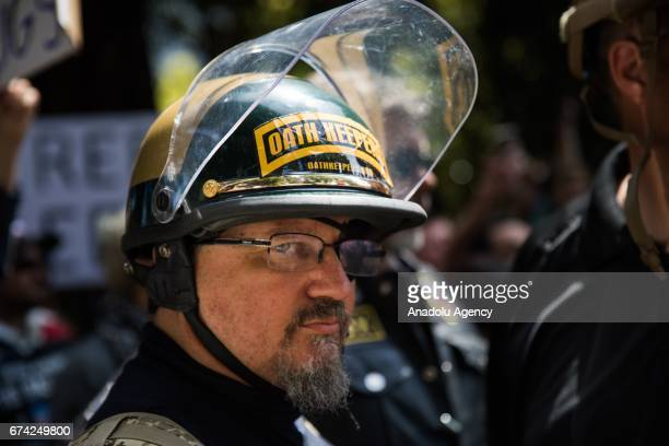 An Oath Keeper brought on to provide security stands guard during a proDonald Trump rally at Martin Luther King Jr Civic Center Park in Berkeley...