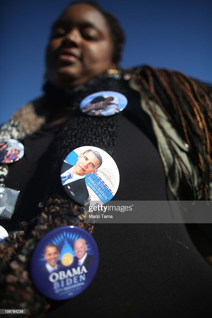An Obama supporter wears buttons during preparations for U.S. President Barack Obama's second inauguration on January 20, 2013 in Washington, DC. The U.S. capital is preparing for the second inauguration of U.S. President Barack Obama, which will take place on January 21.