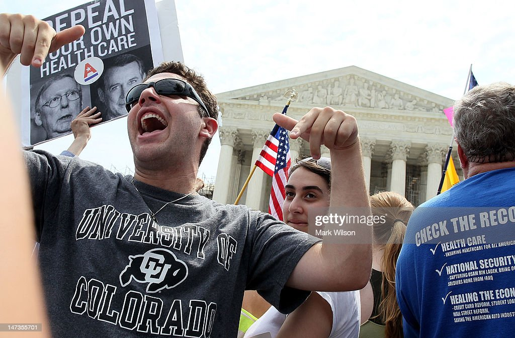 An Obamacare supporter reacts to the U.S. Supreme Court decision to uphold President Obama's health care law, on June 28, 2012 in Washington, DC. Today the high court upheld the whole healthcare law of the Obama Administration.