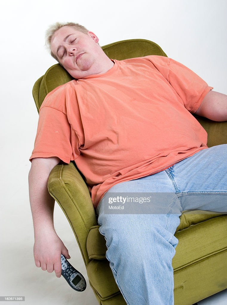 An obese man in orange shirt sleeping while holding a phone & Couch Potato Stock Photos and Pictures | Getty Images islam-shia.org