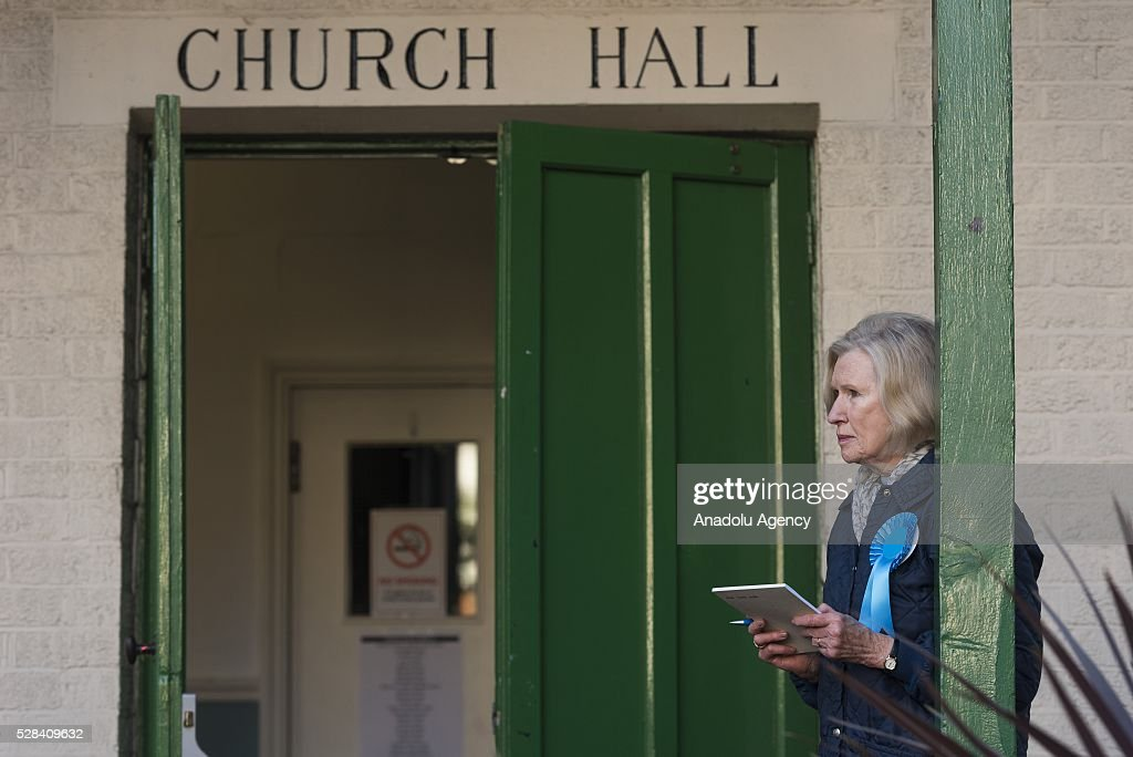 An observer waits outside KItson Hall polling station at the London Mayoral Election in London, United Kingdom on May 05, 2016.