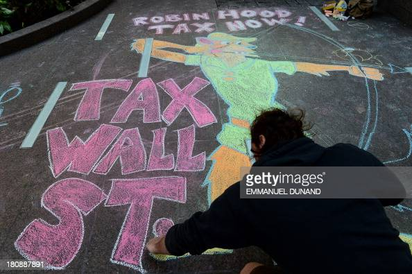 An Occupy Wall Street participant draws a sidewalk chalk drawing during a protest to mark the movement's second anniversary in New York September 17...