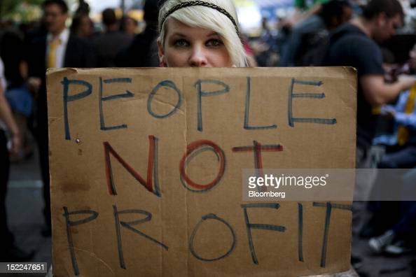 An Occupy Wall Street protester holds a sign during a demonstration in New York US on Monday Sept 17 2012 Occupy Wall Street the protest movement...