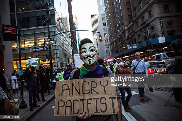 An Occupy Wall Street protester participates in a march from the United Nations building to Bryant Park on September 17 2013 in New York City The...