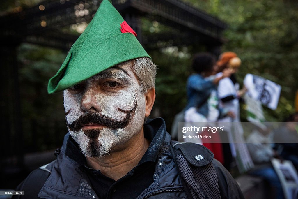 An Occupy Wall Street protester participates in a march from the United Nations building to Bryant Park on September 17, 2013 in New York City. The march centered around the idea of a so-called Robin Hood Tax, a 0.5 percent levy to be applied to financial service companies, with proceeds to be used for social services. Today marks the two year anniversary since the protestors set up camp in New York's financial district, calling for drastic social and finanical reform.