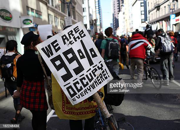 An Occupy Wall Street protestor holds a sign during a demonstration on September 17 2012 in San Francisco California An estimated 100 Occupy Wall...