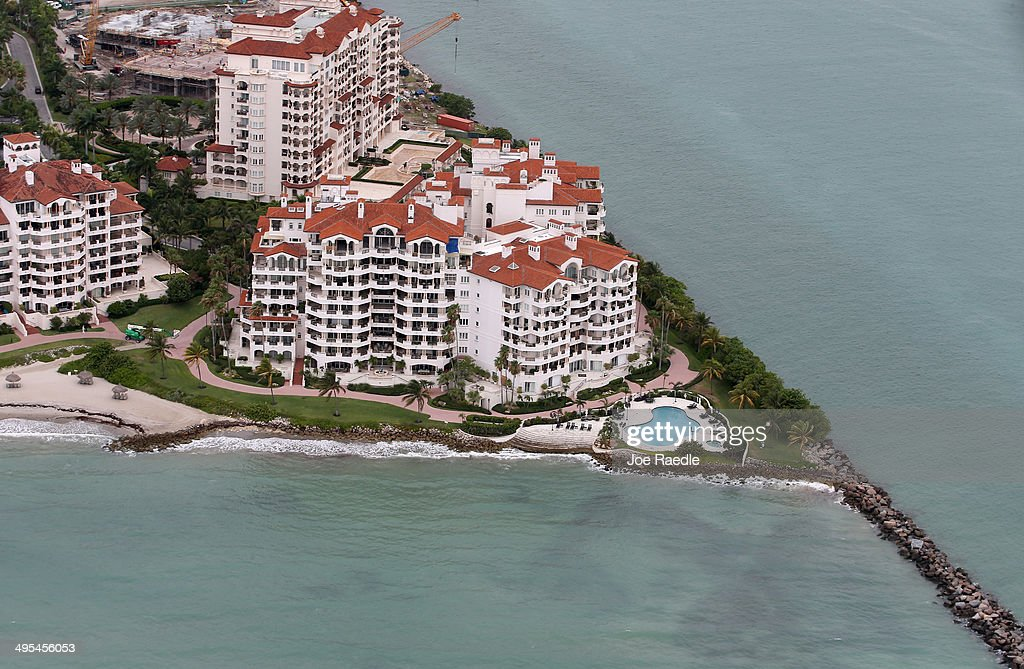 An ocean front condo building is seen June 3, 2014 in Miami, Florida. According to numerous scientists, south Florida could be flooded by the end of the century as global warming continues to melt the Arctic ice, in turn causing oceans to rise. U.S. President Barack Obama and the Environmental Protection Agency yesterday announced a rule that would reduce the nation's biggest source of pollution, carbon emissions from power plants, 30% by 2030 compared to 2005 levels. It is widely believed that these emissions are a main cause of global warming.