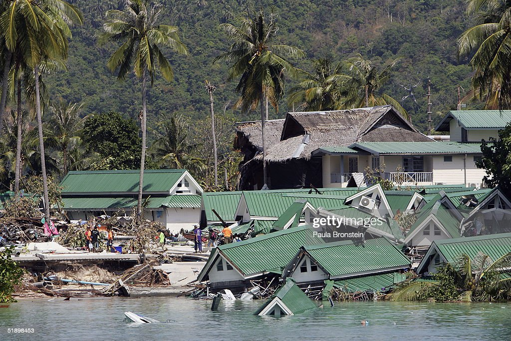 An ocean front hotel is seen collapsed into the sea close to the pier on December 28 2004 on Kho Phi Phi Thailand The Taunamis that ripped through...