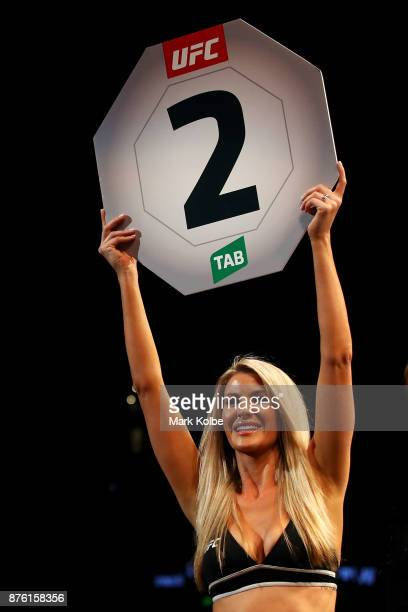 An Octagon girls holds a round two sign during a bout during the UFC Fight Night at Qudos Bank Arena on November 19 2017 in Sydney Australia