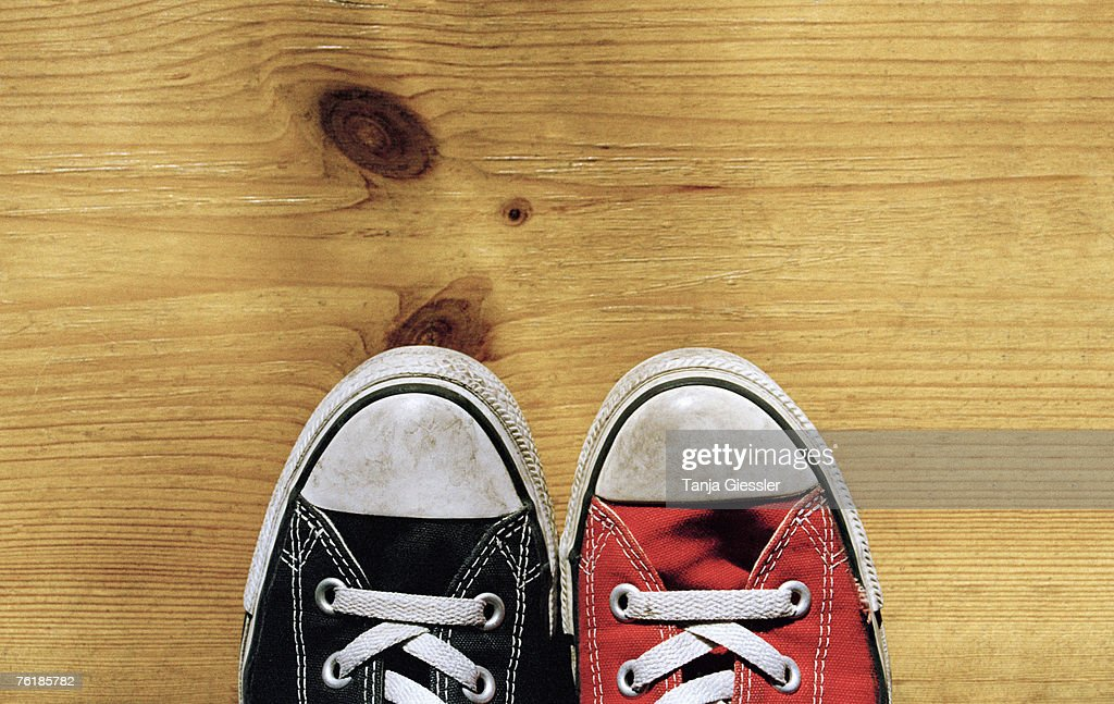 An odd pair of canvas shoes