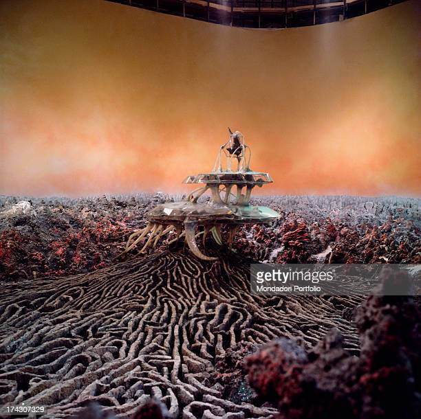 An odd spaceship with a single seater on its top is landed in the middle of the vulcanic scenario of planet Lytheon's labyrinth with a painted orange...
