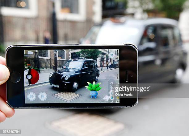 An Oddish Pokemon character appears in front of a London taxi during a game of Pokemon Go a mobile game that has become a global phenomenon on July...