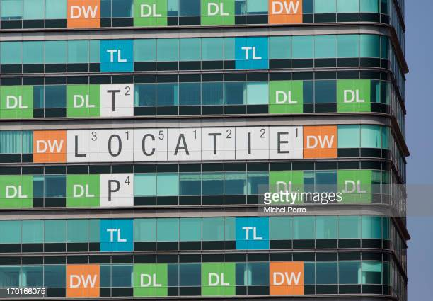 An office building in an industrial and office district is morphed into a Wordfeud game displaying the words 'Top Location' to attract rental...