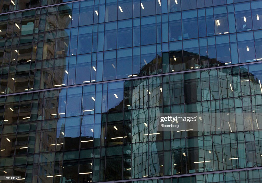 An office building is reflected on the facade of another building in the central business district in Auckland, New Zealand, on Monday, Aug. 12, 2013. New Zealand's growth rate is forecast to outpace Australia's for the next two years, helping stem an exodus that's resulted in the highest proportion of its people living overseas in the developed world after Ireland. Photographer: Brendon O'Hagan/Bloomberg via Getty Images