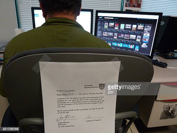 An office chair is adorned with Team USA's letter ostensibly from coach Jurgen Klinsmann for fans to fill in and give to their bosses on June 26...