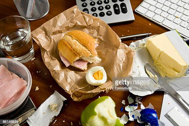 An office desk cluttered with food