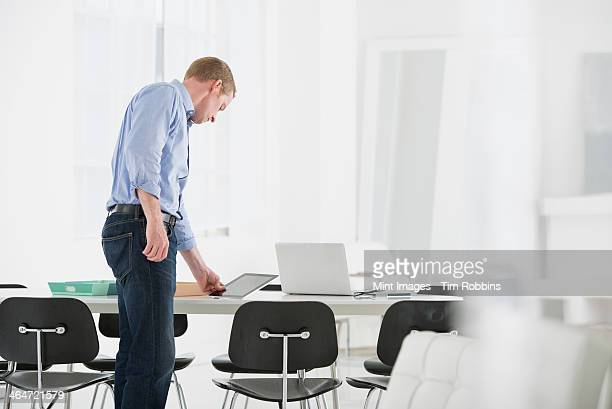 An office in the city. Business. A man checking something on his desk.