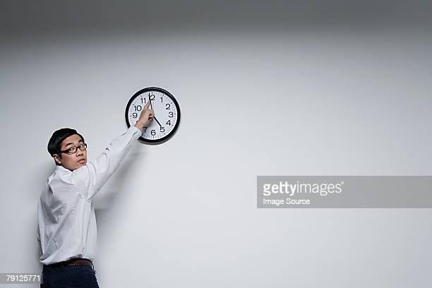 An office moving a clocks hands