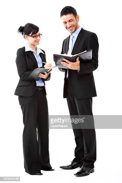 An office staff making an appointment using a planner