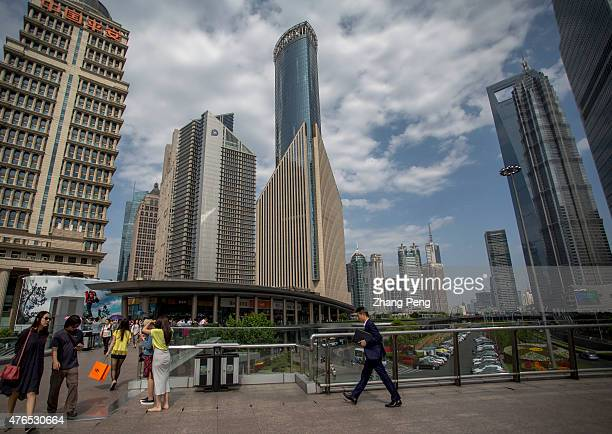 An office whitecollar hurries walking on the footbridge connecting the skyscrapers in Lujiazui Located in the Pudong New District on the eastern bank...