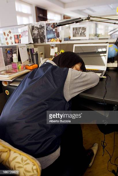 An office worker at a magazine publishing company takes her daily nap Companies in Taiwan are encouraged to allow their employees to take a small...