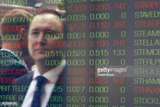 An office worker is reflected on a window of the Australian Securities Exchange building on November 10 2016 in Sydney Australia Americans voted...